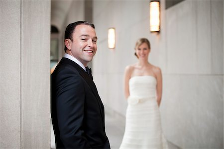 Portrait of Groom with Bride in Background Stock Photo - Premium Royalty-Free, Code: 600-05786579