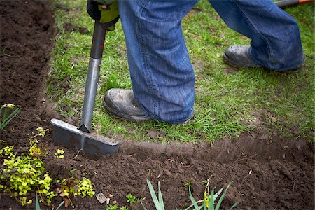 Gardener Edging Garden in Spring, Toronto, Ontario, Canada Stock Photo - Premium Royalty-Free, Code: 600-05800647
