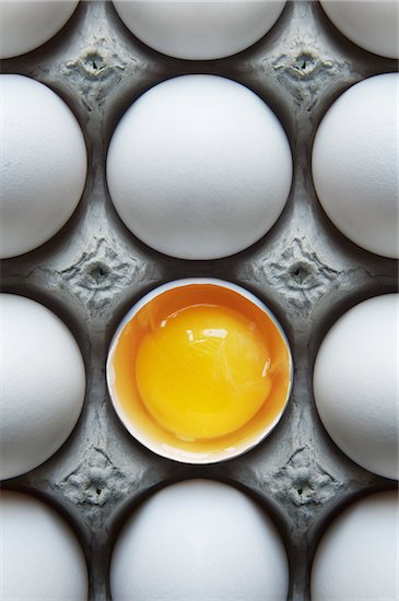 Eggs in Carton with One Broken Shell Stock Photo - Premium Royalty-Free, Artist: Andrew Kolb, Image code: 600-05803156