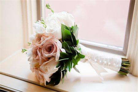 Close-up of Bridal Bouquet on Window Sill Stock Photo - Premium Royalty-Free, Code: 600-05803394