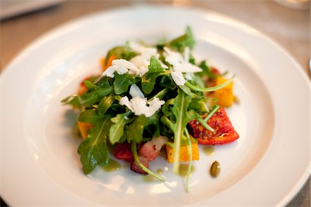 Close-up of Arugula Salad on Plate Stock Photo - Premium Royalty-Free, Code: 600-05803396