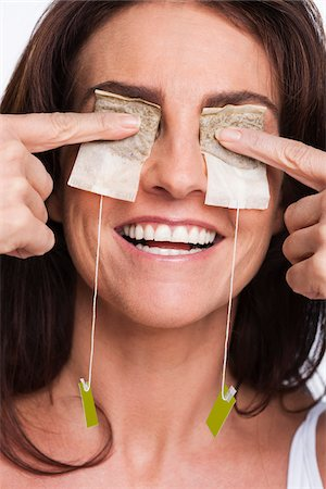 facial - Portrait of Woman with Herbal Tea Bags Covering Eyes Stock Photo - Premium Royalty-Free, Code: 600-05803531