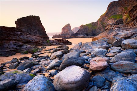Boulders and Sea Stacks at Low Tide, Bedruthan Steps, Cornwall, England Stock Photo - Premium Royalty-Free, Code: 600-05803659