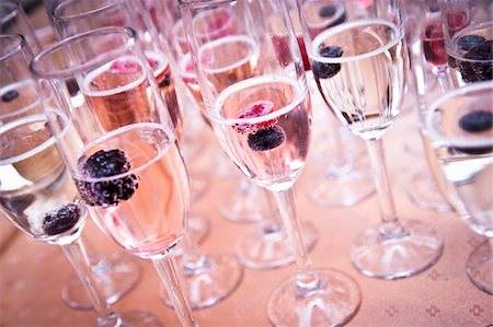 event - Close-up of Champagne Glasses filled with Sparkling Wine Stock Photo - Premium Royalty-Free, Code: 600-05822166