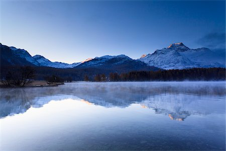 Piz de la Margna Reflected in Lake Sils, Engadin, Switzerland Stock Photo - Premium Royalty-Free, Code: 600-05837587