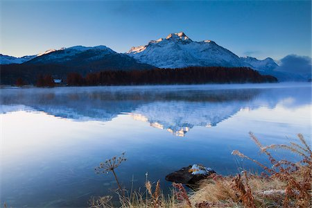 snow capped - Piz de la Margna reflected in Lake Sils, Engadin, Switzerland Stock Photo - Premium Royalty-Free, Code: 600-05837588