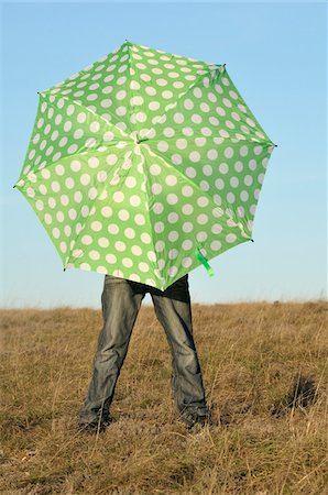 Boy with Umbrella in Field, Rogues, France Stock Photo - Premium Royalty-Free, Code: 600-05855273