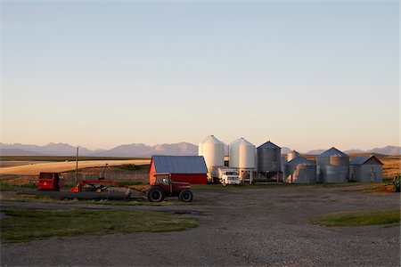Farm with Barn, Tractors and Silos, Pincher Creek, Alberta, Canada Stock Photo - Premium Royalty-Free, Code: 600-05855353