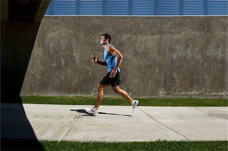 runner (male) - Man Running on Sidewalk Stock Photo - Premium Royalty-Free, Code: 600-05947636