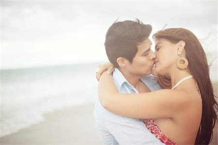 Couple Kissing at Beach, Jupiter, Palm Beach County, Florida, USA Stock Photo - Premium Royalty-Free, Code: 600-05947639