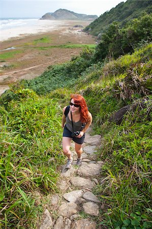 Woman Hiking up Coastal Hills, Ilha do Mel, Parana, Brazil Stock Photo - Premium Royalty-Free, Code: 600-05947909