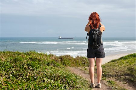 Backview of Woman Hiking and Looking at View, Ilha do Mel, Parana, Brazil Stock Photo - Premium Royalty-Free, Code: 600-05947901