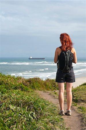 Backview of Woman Hiking and Looking at View, Ilha do Mel, Parana, Brazil Stock Photo - Premium Royalty-Free, Code: 600-05947910