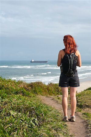 Backview of Woman Hiking and Looking at View, Ilha do Mel, Parana, Brazil Stock Photo - Premium Royalty-Free, Code: 600-05947910