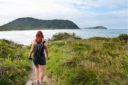 Backview of Woman Hiking, Ilha do Mel, Parana, Brazil Stock Photo - Premium Royalty-Free, Code: 600-05947911