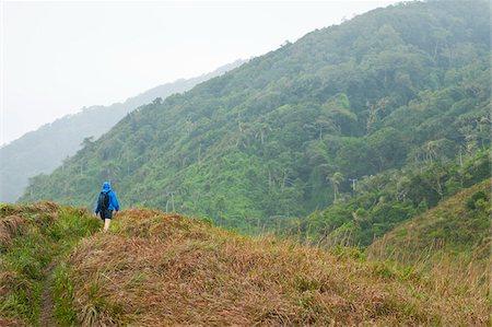 Backview of Woman Hiking, Ilha do Mel, Parana, Brazil Stock Photo - Premium Royalty-Free, Code: 600-05947925