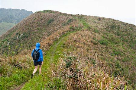 Backview of Woman Hiking, Ilha do Mel, Parana, Brazil Stock Photo - Premium Royalty-Free, Code: 600-05947922