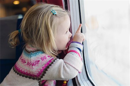 Little Girl using Pacifier and Looking out Train Window Stock Photo - Premium Royalty-Free, Code: 600-05973085