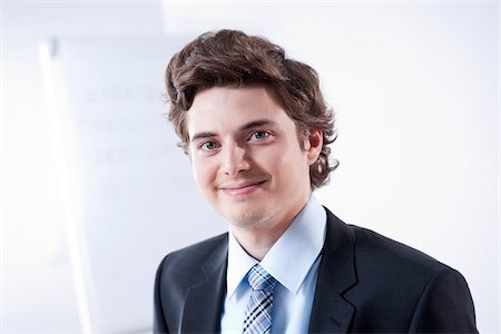 Close-up Portrait of Young Businessman Stock Photo - Premium Royalty-Free, Code: 600-05973092