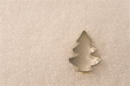 snow christmas tree white - Tree-Shaped Cookie Cutter in Snow Stock Photo - Premium Royalty-Free, Code: 600-05973528