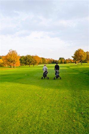 Men on Golf Course, North Rhine-Westphalia, Germany Stock Photo - Premium Royalty-Free, Code: 600-05973846