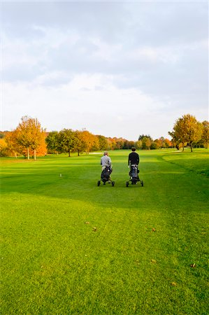 Men on Golf Course, North Rhine-Westphalia, Germany Stock Photo - Premium Royalty-Free, Code: 600-05973846