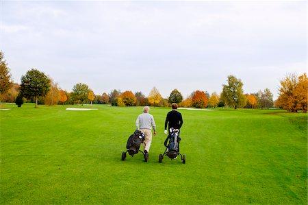 Men on Golf Course, North Rhine-Westphalia, Germany Stock Photo - Premium Royalty-Free, Code: 600-05973847