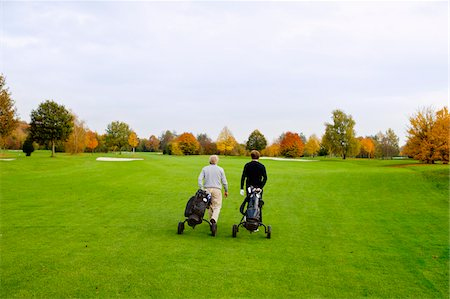 Men on Golf Course, North Rhine-Westphalia, Germany Stock Photo - Premium Royalty-Free, Code: 600-05973847