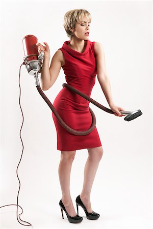 Woman with Vacuum Cleaner Stock Photo - Premium Royalty-Free, Code: 600-05973924