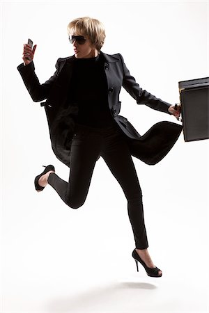 Business Woman Running Stock Photo - Premium Royalty-Free, Code: 600-05973927