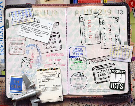 stamped - Passport with Stamps Stock Photo - Premium Royalty-Free, Code: 600-06009105