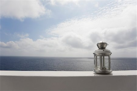 Lantern on Ledge overlooking Sea, Ginostra, Stromboli Island, Aeolian Islands, Italy Stock Photo - Premium Royalty-Free, Code: 600-06009172