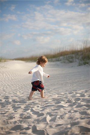 Boy at the Beach, St. Augustine Beach, St. Johns County, Florida, USA Stock Photo - Premium Royalty-Free, Code: 600-06009259