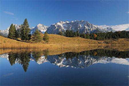 fall trees lake - Wildensee with Karwendel Mountains in Autumn, Mittenwald, Garmisch-Partenkirchen, Upper Bavaria, Bavaria, Germany Stock Photo - Premium Royalty-Free, Code: 600-06038291