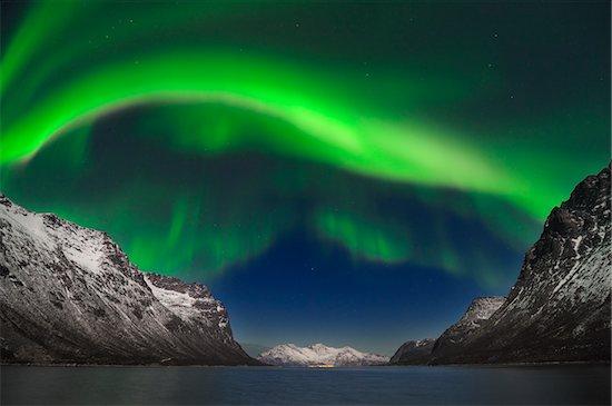 Northern Lights near Tromso, Troms, Norway Stock Photo - Premium Royalty-Free, Artist: Martin Ruegner, Image code: 600-06038349