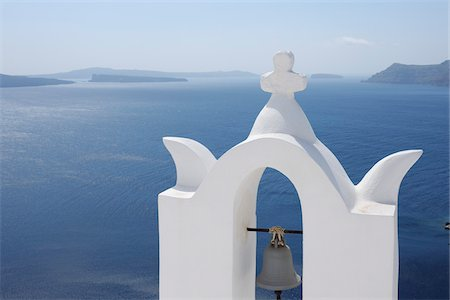 santorini island - Bell Tower with Caldera in the Distance, Oia, Santorini Island, Cyclades Islands, Greek Islands, Greece Stock Photo - Premium Royalty-Free, Code: 600-06125809