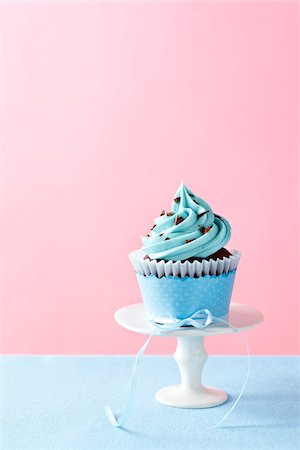 Chocolate Cupcake with Blue Icing Stock Photo - Premium Royalty-Free, Code: 600-06190558