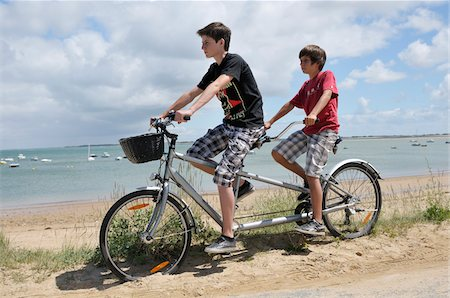 french (places and things) - Brothers Riding Tandem Bicycle on Beach, Ile de Re, France Stock Photo - Premium Royalty-Free, Code: 600-06334393