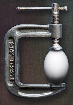fragile - Egg in Vise Stock Photo - Premium Royalty-Free, Code: 600-06334552