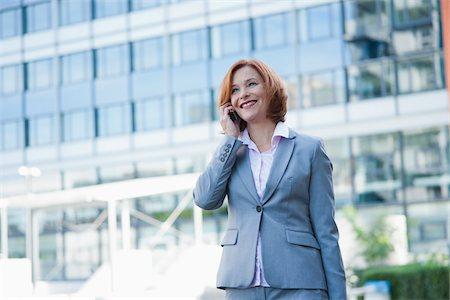 Businesswoman on Cellphone, Niederrad, Frankfurt, Germany Stock Photo - Premium Royalty-Free, Code: 600-06355225