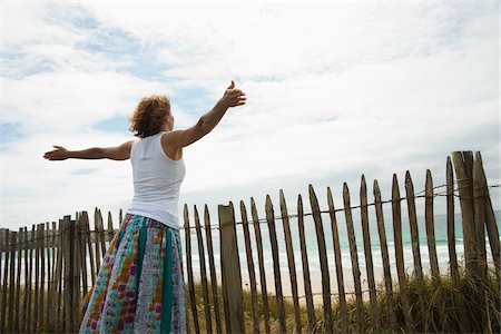 Woman with Open Arms at the Beach, Camaret-sur-Mer, Crozon Peninsula, Finistere, Brittany, France Stock Photo - Premium Royalty-Free, Code: 600-06382809