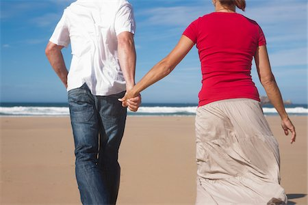 Couple Holding Hands and Walking on the Beach, Camaret-sur-Mer, Crozon Peninsula, Finistere, Brittany, France Stock Photo - Premium Royalty-Free, Code: 600-06382818