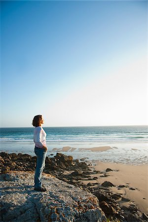 Woman Looking into the Distance at the Beach, Camaret-sur-Mer, Crozon Peninsula, Finistere, Brittany, France Stock Photo - Premium Royalty-Free, Code: 600-06382827