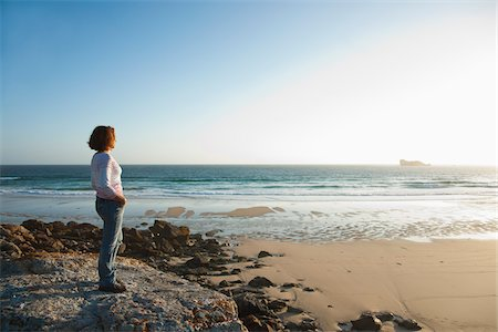 female only - Woman Looking into the Distance at the Beach, Camaret-sur-Mer, Crozon Peninsula, Finistere, Brittany, France Stock Photo - Premium Royalty-Free, Code: 600-06382828