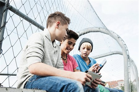 Boys with Tablets and Video Games in Playground, Mannheim, Baden-Wurttemberg, Germany Stock Photo - Premium Royalty-Free, Code: 600-06382854