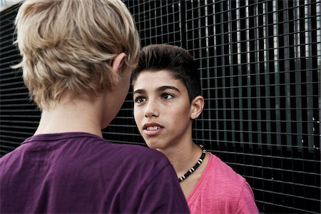 Boys Looking at Each Other, Mannheim, Baden-Wurttemberg, Germany Stock Photo - Premium Royalty-Free, Code: 600-06382857