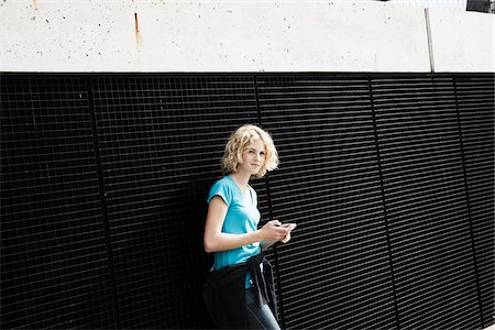 Girl Holding Tablet in Playground, Mannheim, Baden-Wurttemberg, Germany Stock Photo - Premium Royalty-Free, Code: 600-06382868