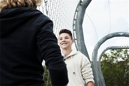 Girl and Boy Talking in Playground, Mannheim, Baden-Wurttemberg, Germany Stock Photo - Premium Royalty-Free, Code: 600-06382874