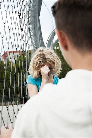sad lovers break up - Upset Girl and Boy Talking in Playground, Mannheim, Baden-Wurttemberg, Germany Stock Photo - Premium Royalty-Free, Code: 600-06382877