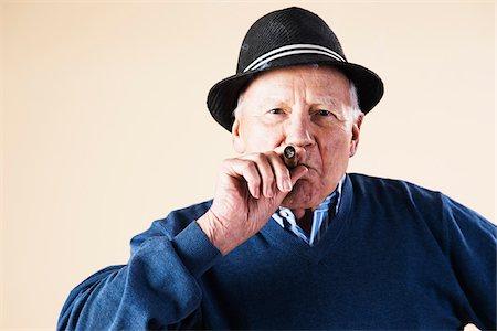 Portrait of Senior Man Smoking Cigar Stock Photo - Premium Royalty-Free, Code: 600-06382926
